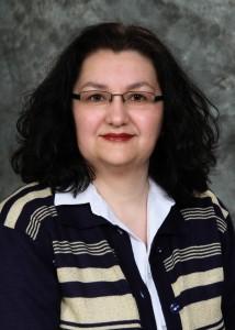 Жанета Б. Козомара- професор